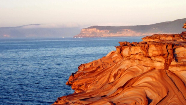 Educational escape ... sandstone swirls in Bouddi National Park.