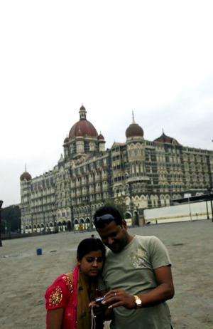 New life ... visitors in front of the Taj Mahal Palace and Tower.