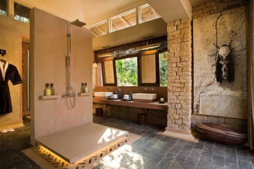 India's Pashan Garh, a dozen dry-stone cottages look rough and tumble from the outside; inside, the posh interiors are ...