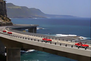 A-list ... Ferraris hug the Sea Cliff Bridge.