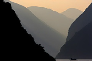 China's life line ... mountains dwarf a boat on the Yangtze.