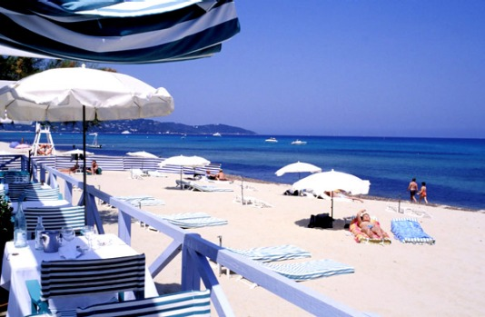 Plage de Tahiti - Saint-Tropez, France. Notoriously decadent Plage de Tahiti occupies the north end of the 5.5 ...