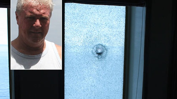 David Nelson, inset, and a bullet hole in one of the ship's portholes.