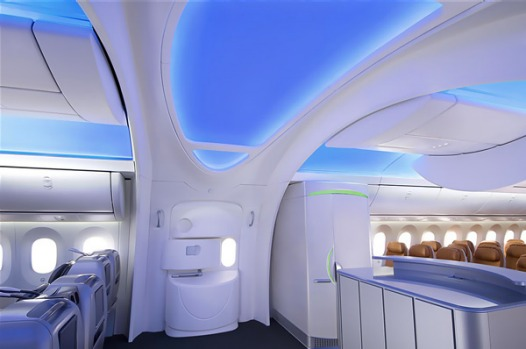 The Boeing 787 Dreamliner entryway is designed with sweeping arches aimed at directing the eye upward.