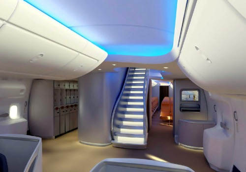 The 747-8 door-two entryway features a dramatic sweeping staircase leading to the upper deck.
