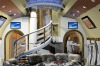 Boeing Business Jets's design concept for the 747-8 VIP jet. A dining area with a spiral staircase and vaulted ceilings.