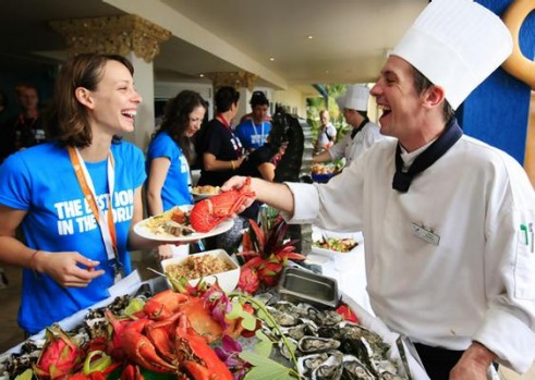 """The Best Job in the World"" competition finalist Cali Lewis of the United States is served from a buffet on Daydream ..."