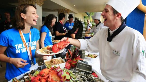 """The Best Job in the World"" competition finalist Cali Lewis of the United States is served from a buffet on Daydream Island, about 950km (590 miles) north of Brisbane."