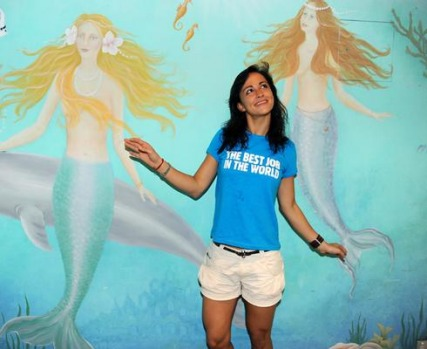 'Best Job In The World' finalist Magali Heuberger of the Netherlands poses in front of a mermaid mural on Daydream ...