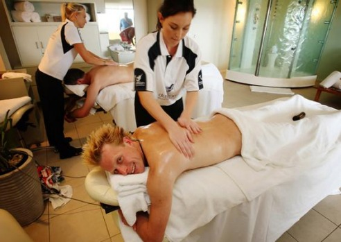 """The Best Job in the World"" competition finalist Ben Southall of Britain receives a massage on Daydream Island, about ..."