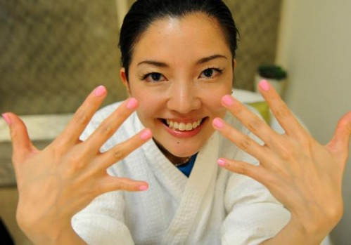 'Best Job In The World' finalist Mieko Kobayashi of Japan shows off her nails after a manicure at the resort's spa on ...