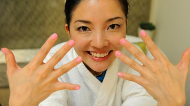 'Best Job In The World' finalist Mieko Kobayashi of Japan shows off her nails after a manicure at the resort's spa on Daydream Island in the Whitsunday Islands.