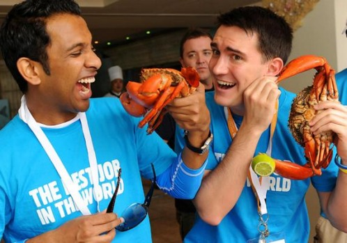 'Best Job In The World' finalists Anjaan RJ (L) of India and Ben Henry (R) of France have some fun with their seafood ...