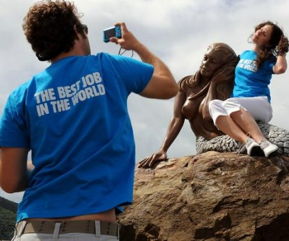 'Best Job In The World' finalist James Hill (L) of Australia takes a photo of Mirjam Novak (R) of Germany on a mermaid ...
