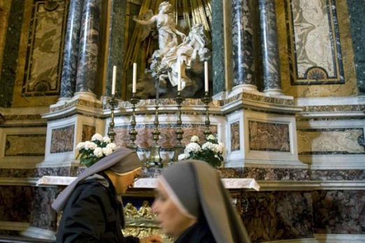 Nuns are seen near Giovanni Lorenzo Bernini's sculpture the Ecstasy of St Theresa.