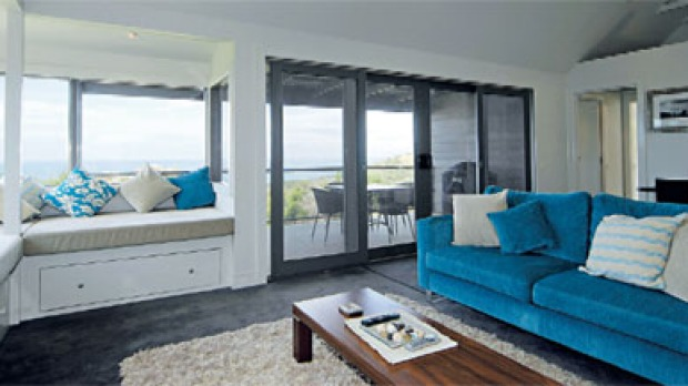 Window with a seat ... the perfect spot for reading and gazing to sea.