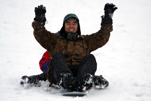 Jeremy Ong of Melbourne, enjoys the first snow at the start of the ski season at Falls Creek. Around 10cm of snow ...