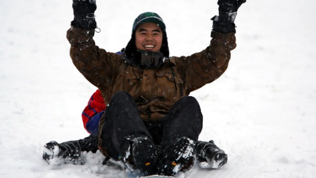 Jeremy Ong of Melbourne, enjoys the first snow at the start of the ski season at Falls Creek. Around 10cm of snow blanketed the Alps over the weekend.