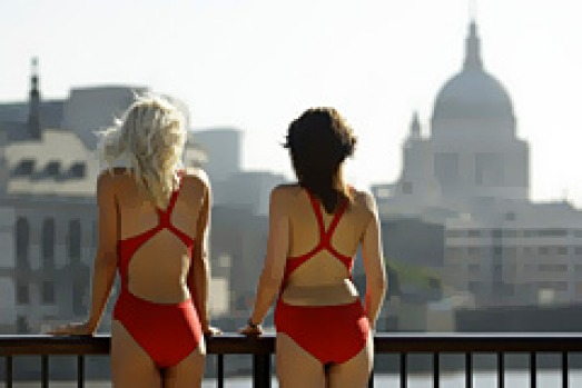 Models pose for photographs on a mock-up of Australia's Bondi Beach on the south bank of the River Thames.