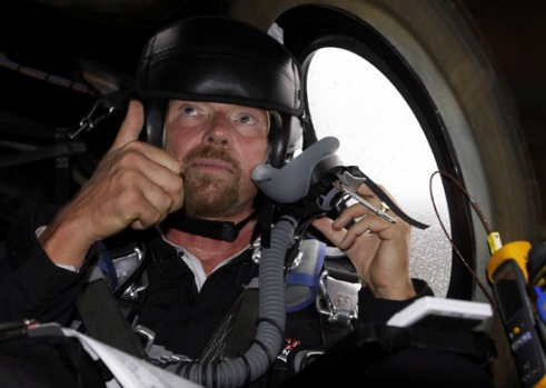 Richard Branson gives a thumbs up as he gets pre-flight instructions in preparation to fly on WhiteKnightTwo.