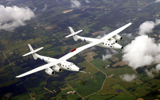 Virgin WhiteKnightTwo, nicknamed Eve, designed by Burt Rutan and financed by Richard Branson, approaches the Wittman ...