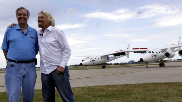 Burt Rutan, the designer of Virgin Mother Ship Eve and Richard Branson celebrate as the plane, also known as White ...
