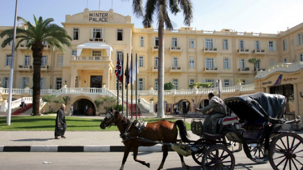 Modern history ... an Egyptian horse-drawn carriage wheels past the Winter Palace.