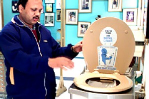 A man looks through exhibits at the Toilet Museum in New Delhi.