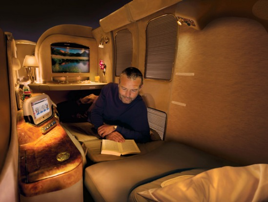 """You inhabit your own suite with sliding door. The ivory leather seat lies flat (Emirates calls it """"zero gravity"""")."""