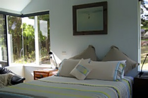 Tucked away in the hills ... the bedroom at Johanna Alpacas has a seaside feel.