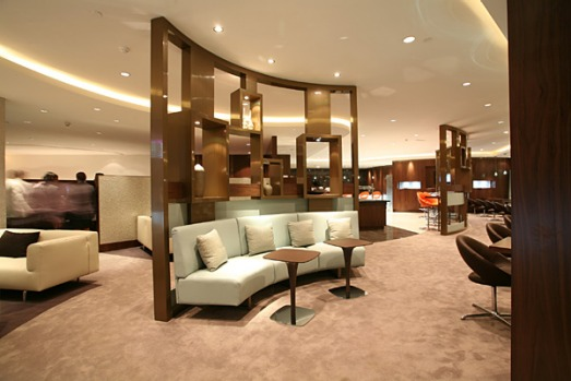 The Pearl Business Class Lounge in Abu Dhabi is a stylish haven of dark wood, leather seats and artfully arranged ...