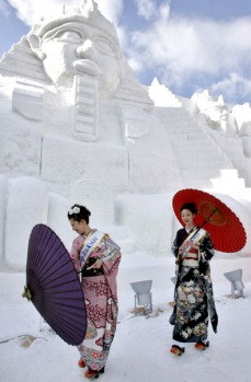 Sapporo Snow Festival. Hokkaido Prefecture, Japan. Picture scores of snow statues and majestic ice sculptures along with ...