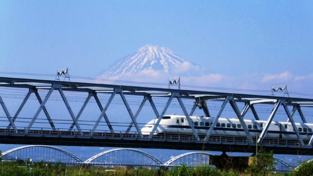 Need for speed ... a bullet train passes Mount Fuji.