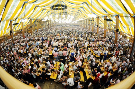 Visitors crowd the Baeurosl beer tent on the second day of the Oktoberfest beer festival.