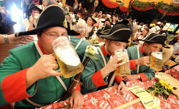 Participants of the marksmen's parade have their first beer.