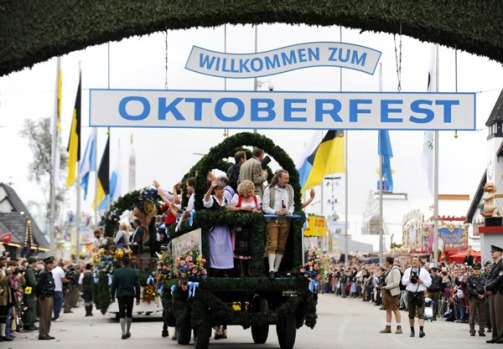 Visitors of the Oktoberfest beer festival celebrate on a float during the opening parade.