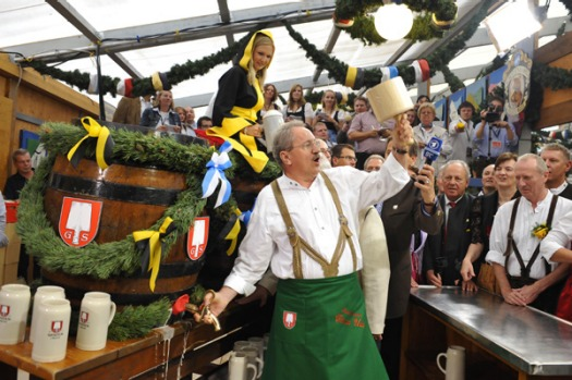 Munich mayor Christian Ude taps the first beer barrel on the first day of the Oktoberfest in Munich.
