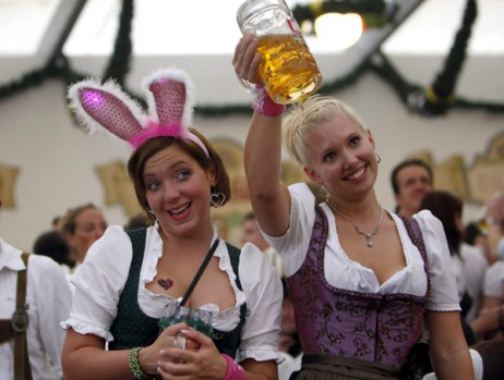 Women in traditional Bavarian Dirndl toast with beer during the 176th Oktoberfest.