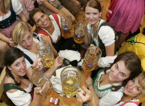 Young women enjoy their beer at the festival.