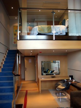 Accommodation includes the more expensive staterooms that span two decks and feature floor-to-ceiling windows with ...
