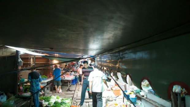 Track trade ... the market's low-hung makeshift roof - a combination that includes tarpaulins and bedspreads - which is ...