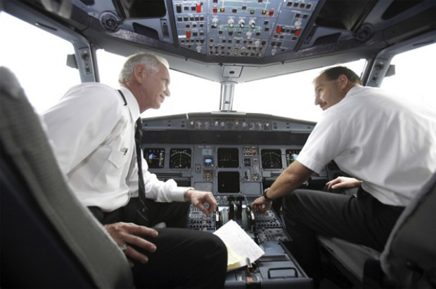 Captain Chesley 'Sully' Sullenberger (left) in his flying days in the cockpit.