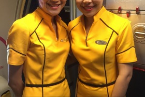 Nok Air's all-female crew wear sunny yellow uniforms.