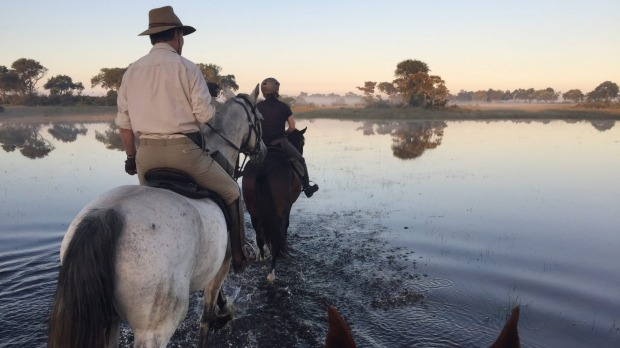 Riding through the Okavango Delta.