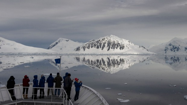 Eco-tourists aboard a cruise ship observe reflections in Crystal Sound.