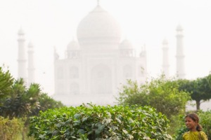 Girls work in the Mehtab Bagh (Moonlight Garden) in sight of the famous Taj Mahal palace.