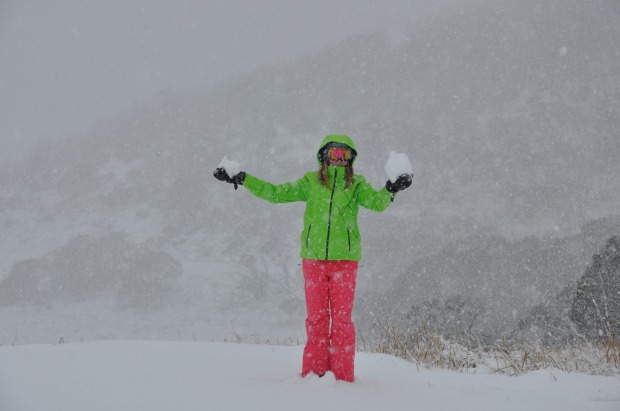 A woman makes snowballs at Perisher over the weekend.