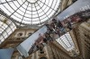 Tourists are reflected in the mirrors of an installation on Milan's history at the restored Galleria Vittorio Emanuele ...