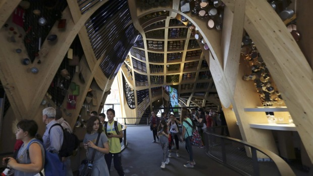 People visit the France pavilion at the Expo 2015 in Milan, northern Italy. Officials are counting on some 20 million ...