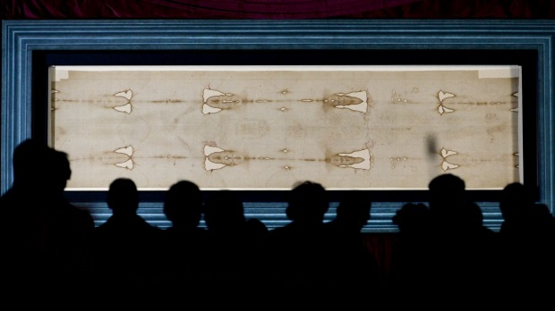 The Holy Shroud, the 14 foot-long linen revered by some as the burial cloth of Jesus, on display at the Cathedral of ...